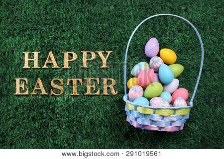 Easter egg basket with Happy Easter text on grass