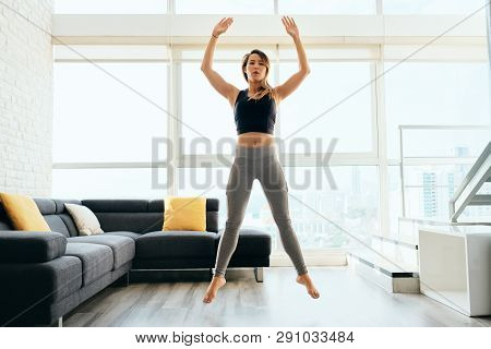 Adult Woman Training Legs Doing Squat And Jumping