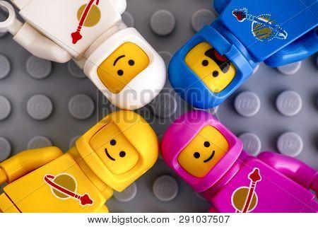 Tambov, Russian Federation - February 24, 2019 Four Lego Astronaut Minifigures On Gray Baseplate Bac