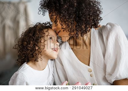 Happy Mother's Day, Daughter Gives A Bouquet Of Tulips. African-american Girl With A Smile Without T