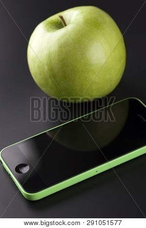 Tambov, Russian Federation - October 16, 2013 Apple Iphone 5c Green Color And Green Apple On Black B