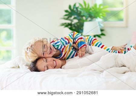 Mother And Child In Bed. Mom And Baby At Home.