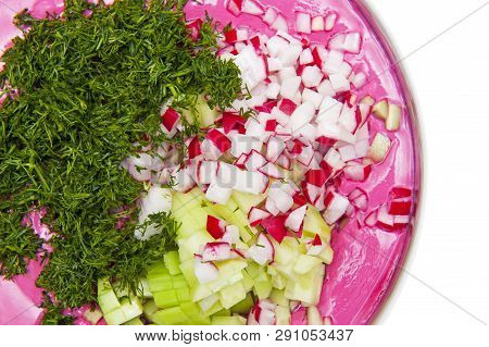 Top View Of Soup Served Cold With Fresh Cucumber, Radish And Dill