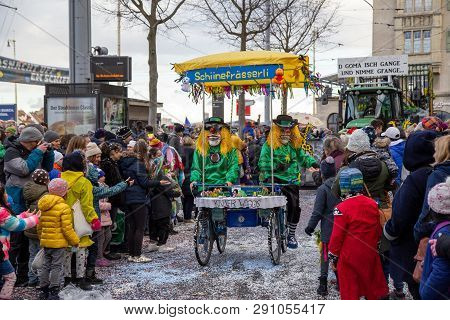 Basel, Switzerland - March 11, 2019: Participants And Spectators At The Parade Of The Yearly Carniva