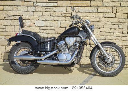 Paphos, Cyprus - November 01, 2013 Motorcycle Honda Steed Vlx Is Standing On The Street Near Brick W