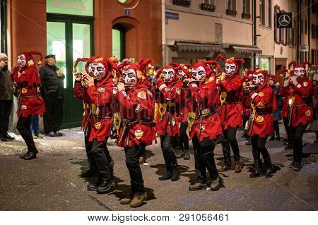 Basel, Switzerland - March 11, 2019: Participants At The Basler Fasnacht At Night. The Carnival Of B