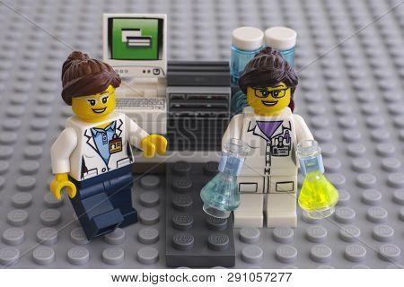 Tambov, Russian Federation - June 10, 2015 Two Lego Scientists Minifigures Near Laboratory Computer