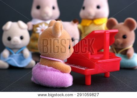 Tambov, Russian Federation - April 01, 2016 Sylvanian Family Piano Concert. Deer Baby Sits By Red Pi
