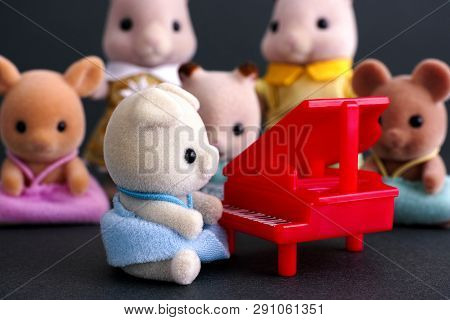 Tambov, Russian Federation - April 01, 2016 Sylvanian Family Piano Concert. Pig Baby Sits By Red Pia