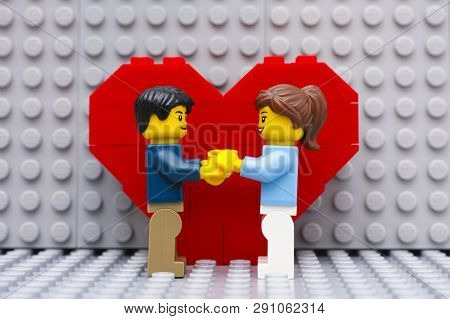 Tambov, Russian Federation - September 03, 2015 Lego Couple Standing In Front Of Heart On Lego Gray