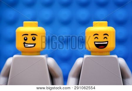 Tambov, Russian Federation - July 24, 2016 Two Lego Minifigures - One With Smirk And One Happy. Blue