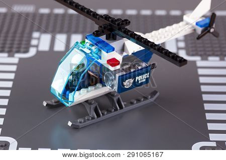 Tambov, Russian Federation - August 27, 2014 Lego Police Helicopter With Pilot On Lego Baseplate Bac
