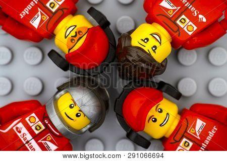 Tambov, Russian Federation - June 15, 2017 Four Lego Ferrari Team Crew Members Minifigures On Gray B
