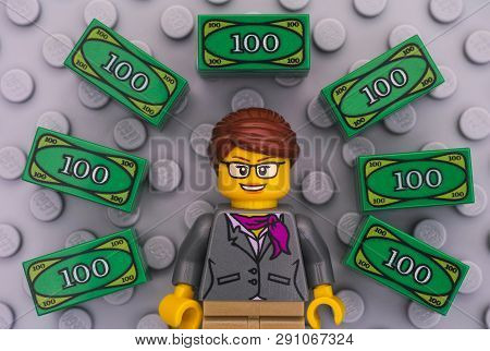 Tambov, Russian Federation - June 22, 2017 Lego Businesswoman And Lego Money On Gray Baseplate Backg
