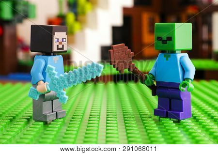 Tambov, Russian Federation - June 25, 2017 Lego Minecraft. Steve Fighting Zombie. Green Baseplate Ba