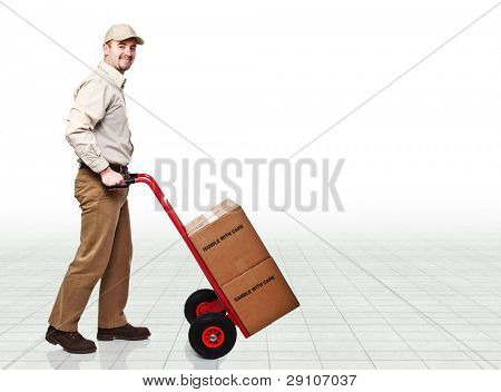 smiling delivery man with handtruck