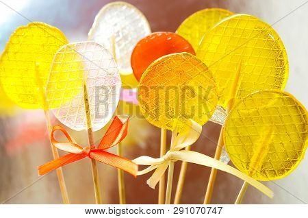 Isomalt Lollipops Cockerels On Sticks Candies. Candy, Lollipop, Bonbon, No-sugar Candy. Sweetmeat No