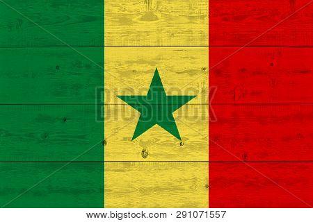 Senegal flag painted on old wood plank. Patriotic background. National flag of Senegal poster