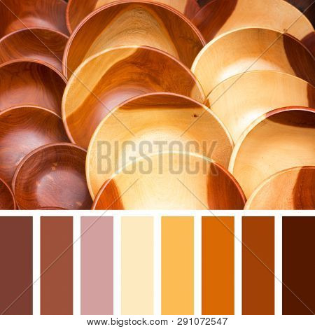 Carved natural wood bowls in a colour palette with complimentary colour swatches.