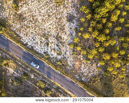 Car Driving Road Through Barren Landscape In Cevennes Near Ganges, Occitania, France