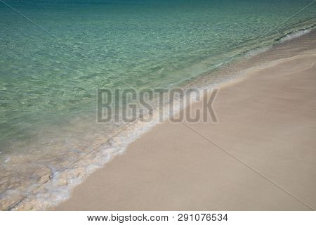 A Beach In The Caribbean With Sand And Cool, Clear Water