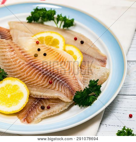 Whitefish Tilapia Fish Raw Fillet On White Wooden Background. Selective Focus.