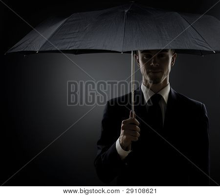portrait the beautiful man in black costume special-service agent or body guard poster