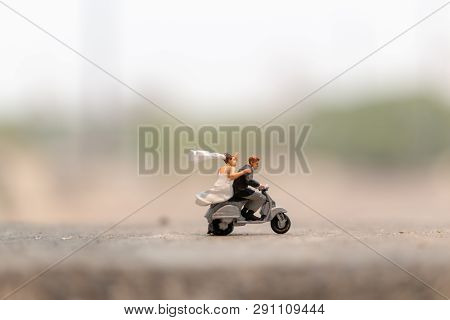 Miniature People : Couple Riding The Motorcycle In The Garden