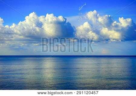 Blue Sky With Beautiful Clouds Over The Sea. Non-urban Scene.