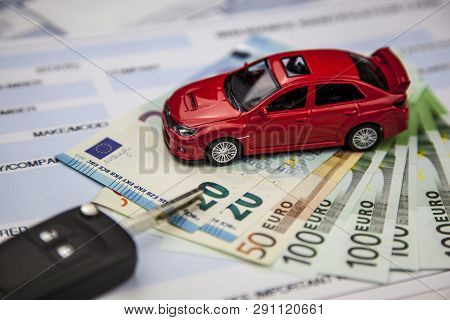 The Concept Of Car Insurance.motor Or Car Insurance Application With Car Model With Keys Against The