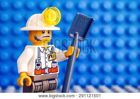 Tambov, Russian Federation - March 09, 2018 Lego Miner With Shovel. Blue Baseplate Background.