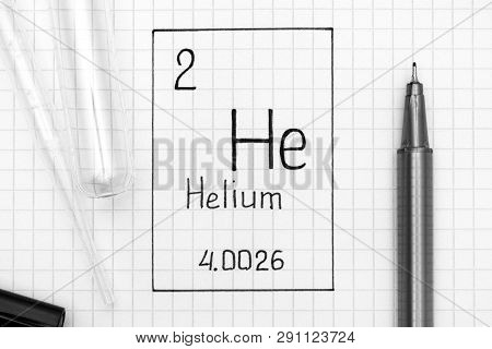 The Periodic table of elements. Handwriting chemical element Helium He with black pen, test tube and pipette. Close-up. poster
