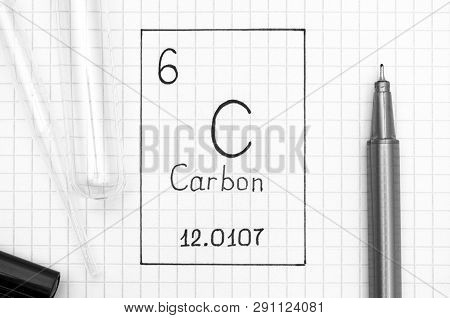 The Periodic table of elements. Handwriting chemical element Carbon C with black pen, test tube and pipette. Close-up. poster