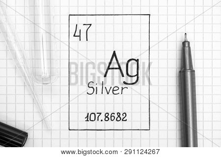 The Periodic table of elements. Handwriting chemical element Silver Ag with black pen, test tube and pipette. Close-up. poster