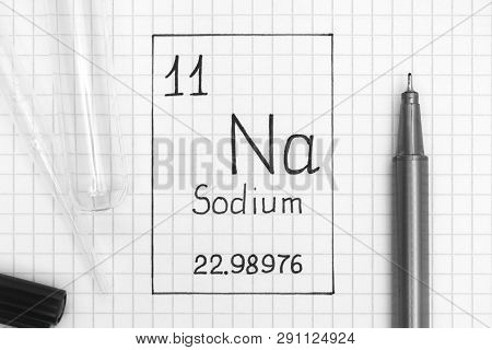 The Periodic Table Of Elements. Handwriting Chemical Element Sodium Na With Black Pen, Test Tube And