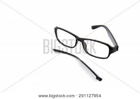 Broken Eye Glasses, Isolated On White Background. Black Celluloid Frame