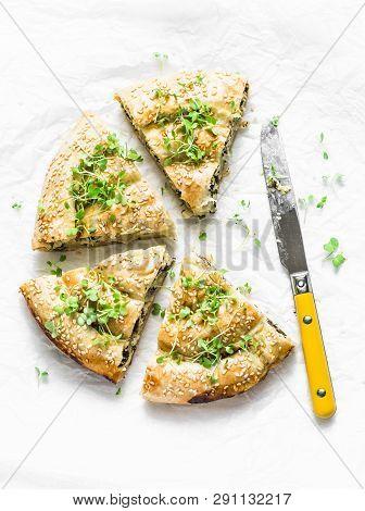 Greek Spinach Fresh Ricotta Puff Pastry Pie On A Light Background, Top View. Spanakopita Pie