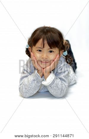 Reclining Japanese Girl With Resting Chin In Hands (4 Years Old)