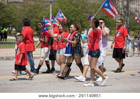 Chicago, Illinois, Usa - June 16, 2018: The Puerto Rican Day Parade, A Group Of Puerto Rican People