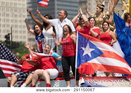 Chicago, Illinois, Usa - June 16, 2018: The Puerto Rican Day Parade, Puerto Rican People On Top Of A