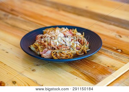 Yakisoba, The Asian - Japan - China And Taiwan Fried Noodle Style On The Wood Table, Serve For Lunch