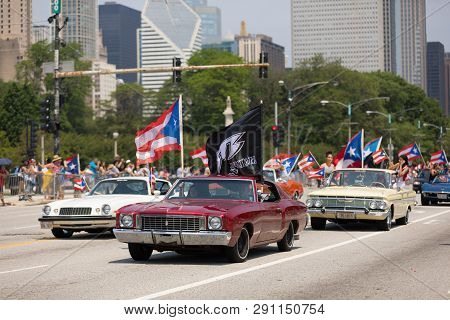 Chicago, Illinois, Usa - June 16, 2018: The Puerto Rican Day Parade, Puerto Rican Driving A  Red Cla