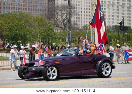 Chicago, Illinois, Usa - June 16, 2018: The Puerto Rican Day Parade, Puerto Rican Driving A Chrysler