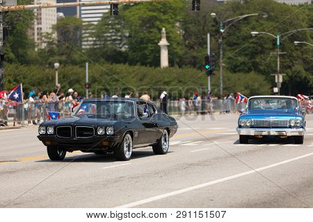 Chicago, Illinois, Usa - June 16, 2018: The Puerto Rican Day Parade, Puerto Rican Driving A Pontiac