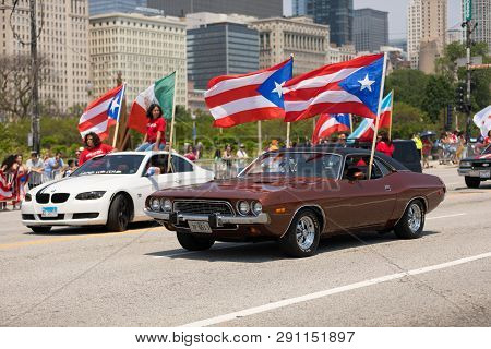 Chicago, Illinois, Usa - June 16, 2018: The Puerto Rican Day Parade, Puerto Rican Driving A Dodge Ch
