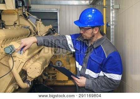 Electromechanic Performs Repair Work On A Diesel Generator