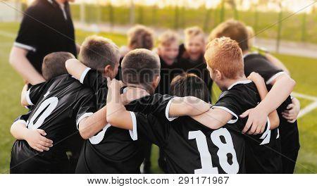 Junior Sport Team Spirit. Boys Sport Team Huddle. Coaching Youth Football Team