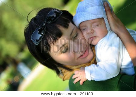Baby Sleeping On Mother'S Arms