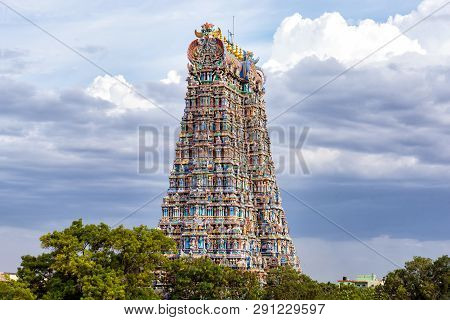 The North Gopuram Of The Meenakshi Temple In Madurai, India. A Gopuram Is A Monumental Gatehouse Tow
