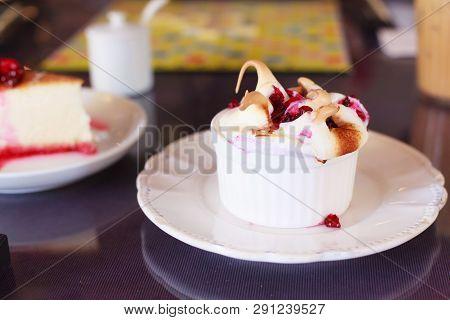 Tasty Delicious Seasonal Fresh Ripe Raspberries Fruit Topping On White Chocolate Muffin. Healthy Swe